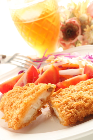 Deep fried fillet fish served with tomoto