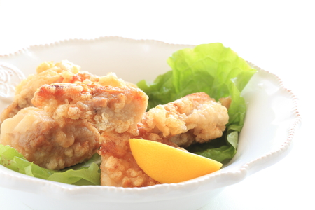 Homemade fried chicken served with lemon