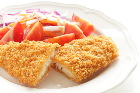 Fish fillet and tomato salad Stock Photo