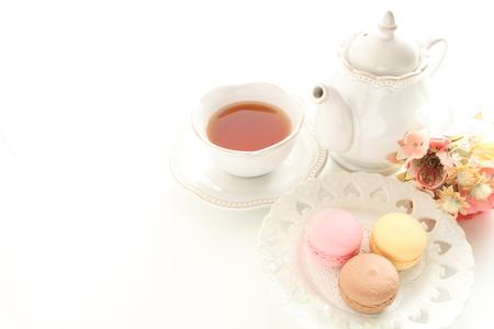 Colorful macaroon and tea for tea breakfast image