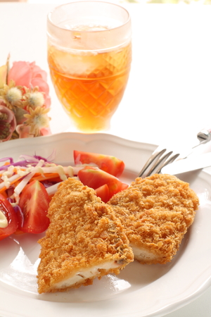 Deep fried fish served with Salad