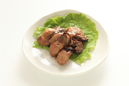 Smoked oyster on lettuce for gourmet food image