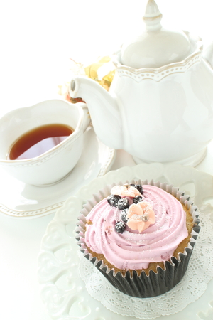 Berry cup cake and tea 写真素材