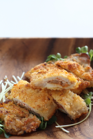 Japanese food, chopped pork cutlet on wooden plate