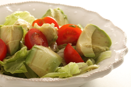 Avocado and tomato salad Stock Photo - 125111298