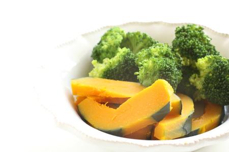 Boiled broccoli and pumpkin on bowl Stock Photo