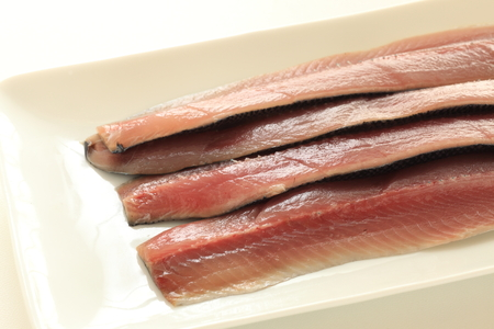 Prepared pacific saury on plate for cooking image Banco de Imagens - 125110956
