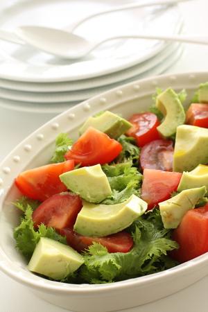 Avocado and tomato salad Stock Photo