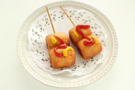 Hot dog on dish