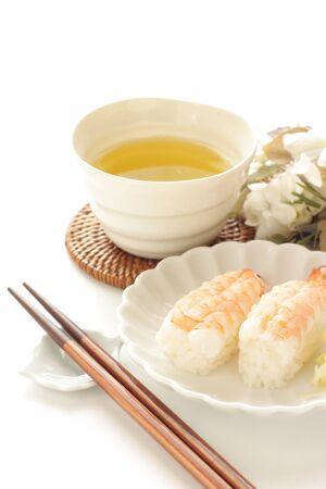 Japanese food, shrimp sushi on dish and green tea