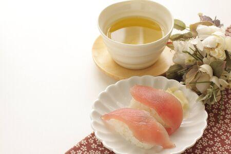 Japanese food, tuna sushi on dish and green tea Stock Photo