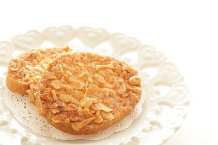Almond rusk on white dish with copy space Stockfoto