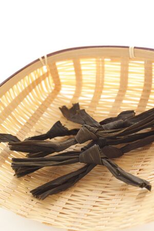 Japanese food ingredient, dried Kombu on bamboo basket Stock Photo