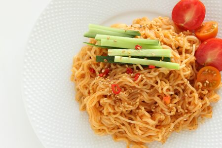 Asian food, spicy mixed noodle salad with vegetable
