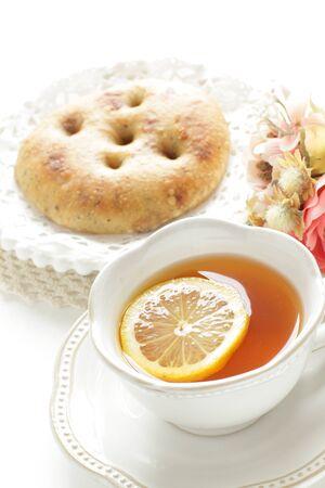 Italian bread, foccacia and lemon tea for breakfast image