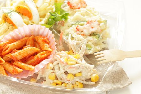 corn salad and pasta for take out food image Фото со стока