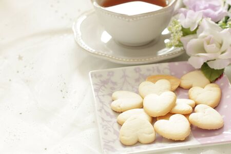 heart shaped cookie on dish with copy space Stock Photo