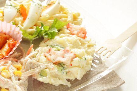 Potato salad on food tray Standard-Bild - 127619849