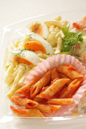 Tomato penne short pasta and egg salad
