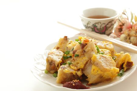Chinese new year food, egg and turnip cake stir fried Stock Photo