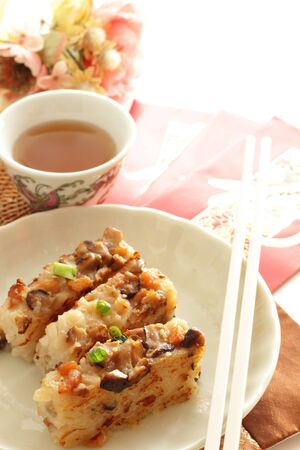 Chinese food, turnip cake on dish with copy space Stock Photo