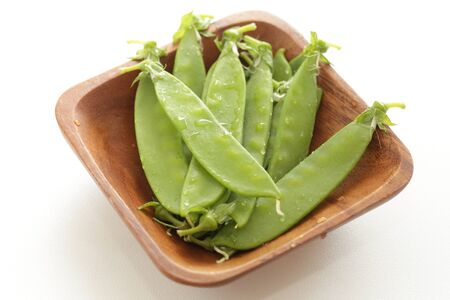 Japanese pea on wooden plate for ingredient image Stock Photo