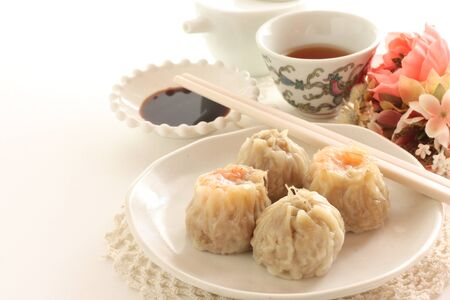 Assorted Chinese dim sum and tea Stock Photo