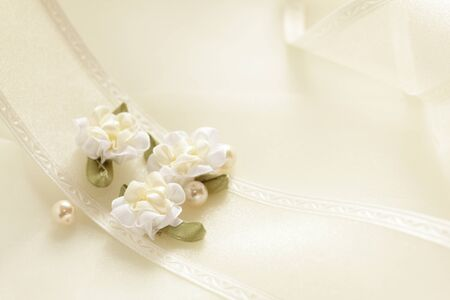Artificial flower and ribbon