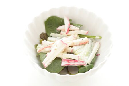 Radish and mayonnaise salad on green leaf vegetable
