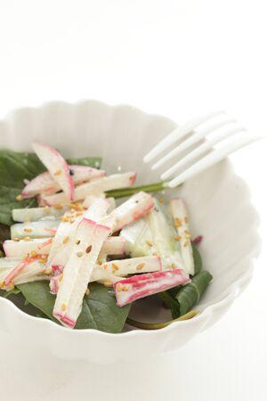Radish and mayonnaise salad on green leaf vegetable
