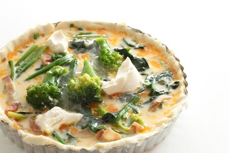 Prepared spinach and cheese for quiche cooking image