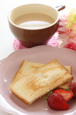 Sugar rusk and milk tea Stockfoto