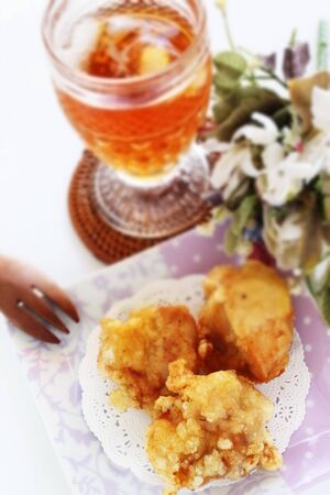Chinese food, fried chicken on dish and tea