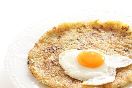 Potato pancake with copy space on white background Stock Photo