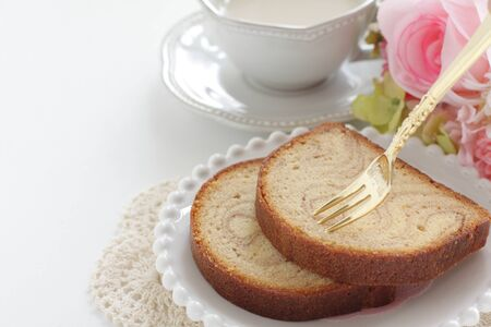 Marble syrup cake on dish served with milk tea Stock fotó