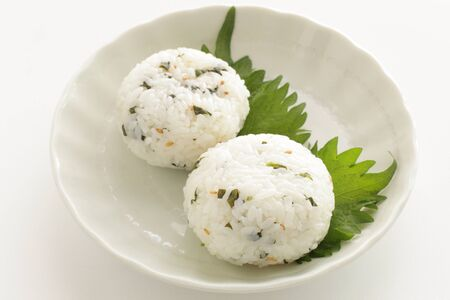 Japanese food, green leaf and sesame seed rice ball Stock Photo