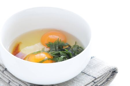 Japanese cooking, egg and soy sauce with oba
