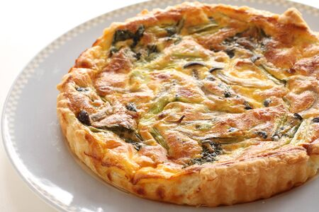 French food, Piece of shimeji mushroom and bacon quiche Stock Photo