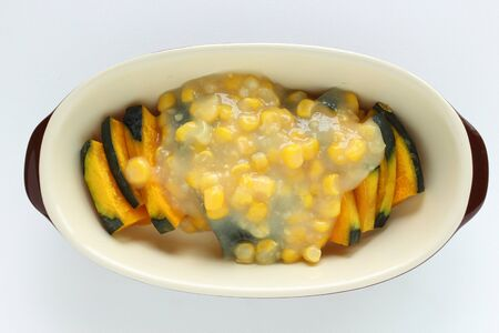cream sweet corn on steamed pumpkin prepared for gratin cooking 写真素材