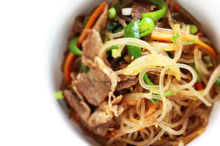 Korean food, glass noodles and beef stir fried with vegetable