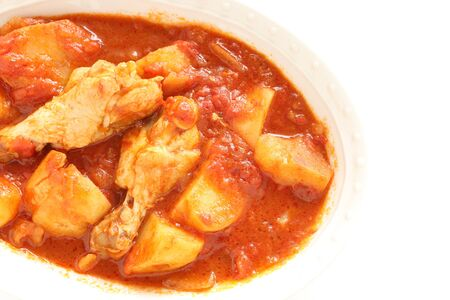 Italian food, chicken drumsticks and potato simmered with tomato