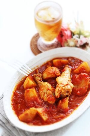 Italian food, chicken drumsticks and potato simmered with tea