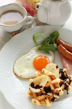 Banana waffle and sausage with tea