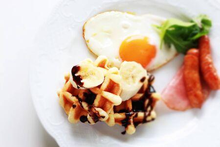 Sunny side up fried egg and banana waffle