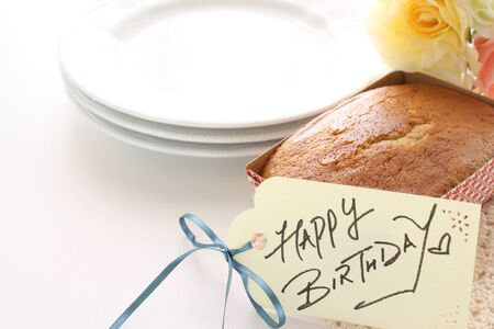 Birthday card and pound cake with flower Stock fotó