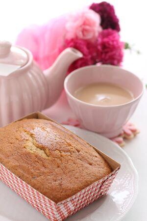 pound cake in paper box and milk tea