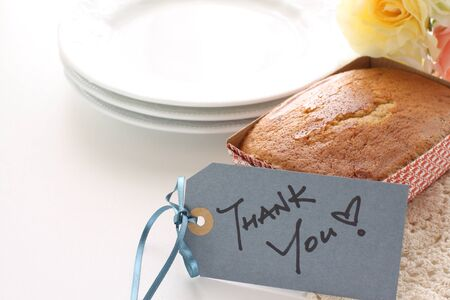 pound cake in paper box and milk tea with thank you card