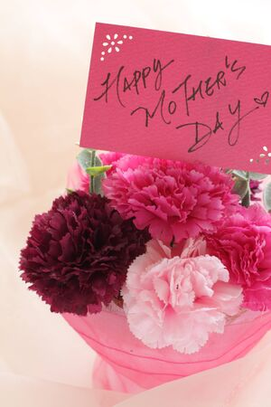 artificial carnation and happy written card