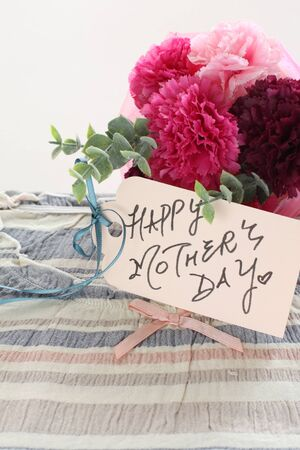 artificial flower and hand writing Mothers Day card