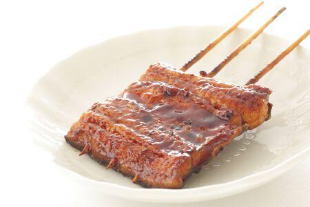 Cuisine japonaise, anguille grillée sur plat avec espace de copie